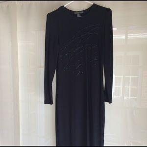 Elegant black cocktail dress with sequin applique